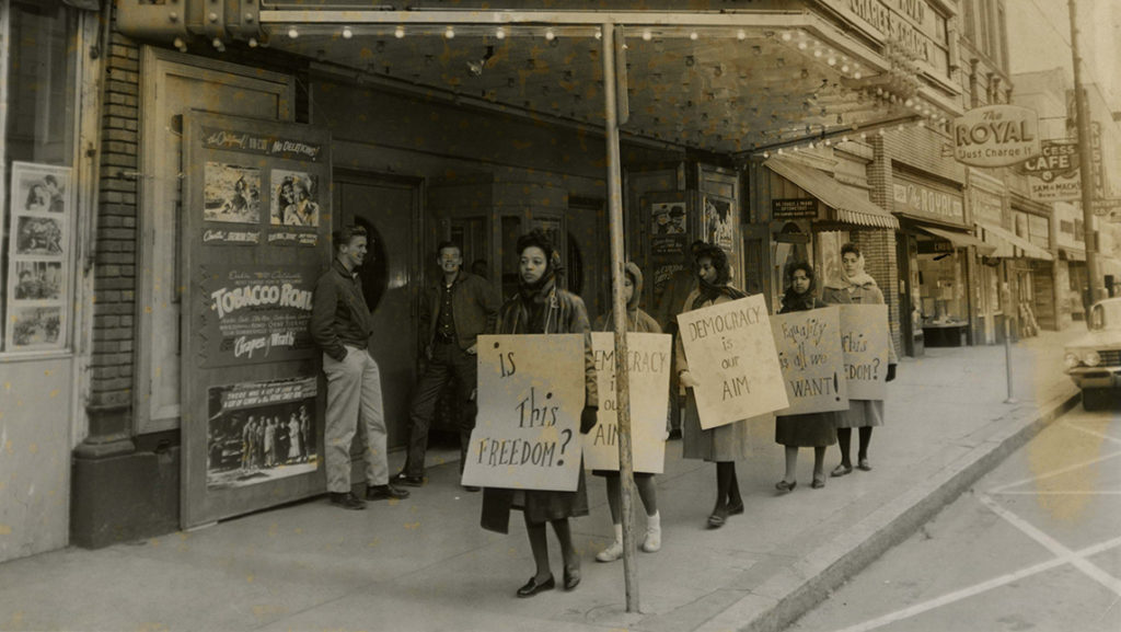 Archival photo of protesters in downtown